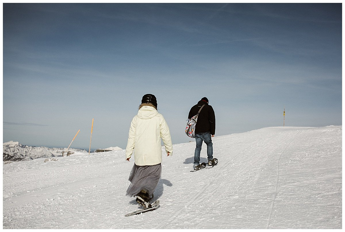 Snowshoe hike winter engagement in Hallstatt