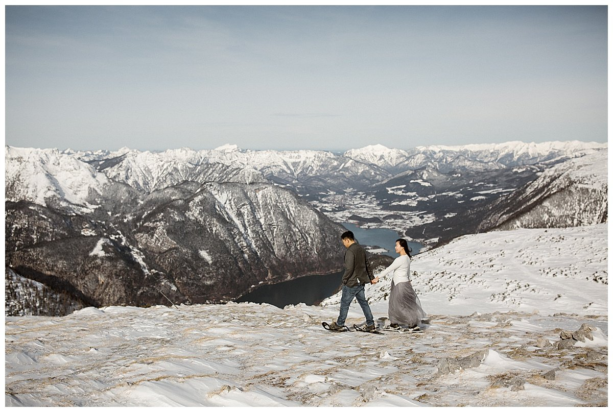 Snowshoe hike winter engagement in Hallstatt