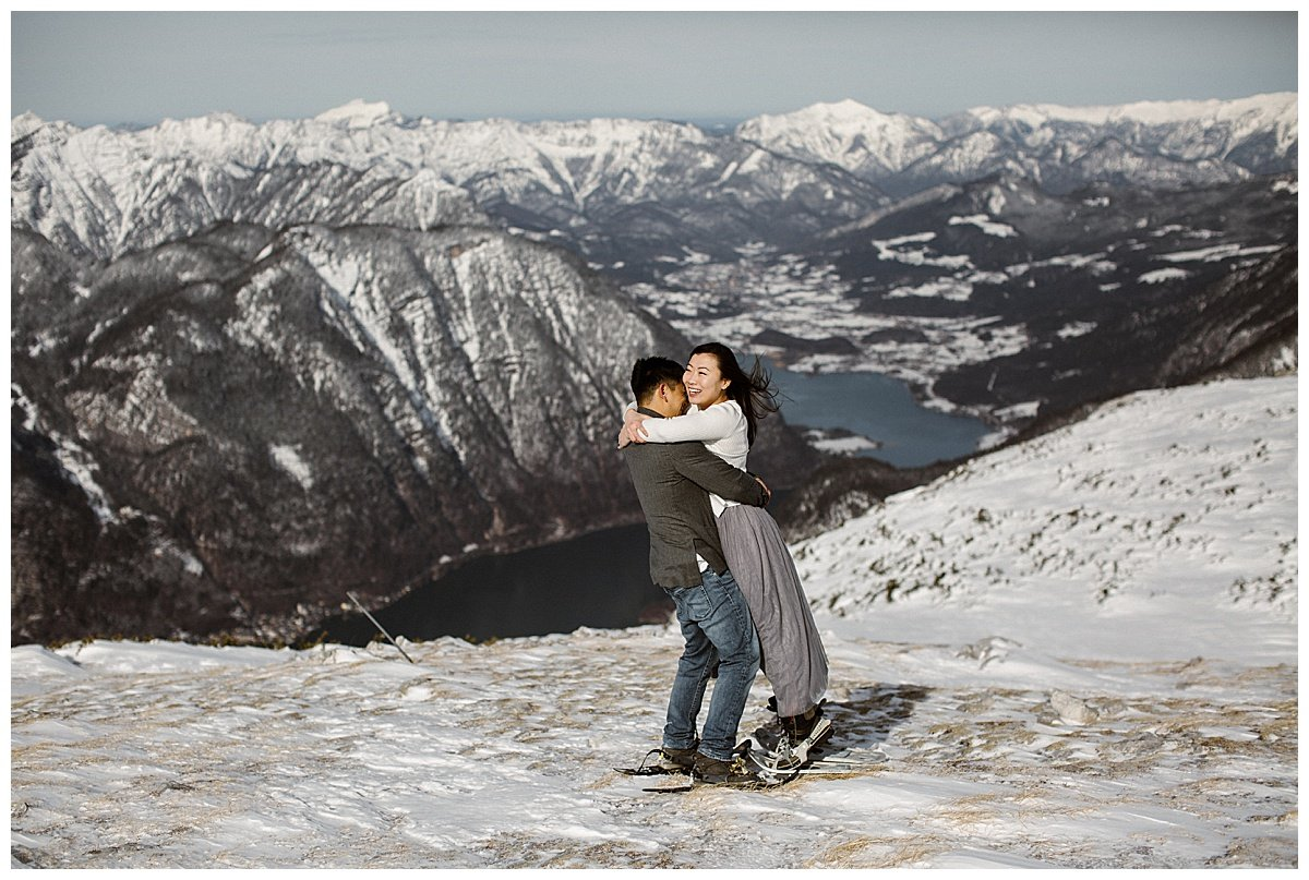Snowshoe hike engagement photos in Austria