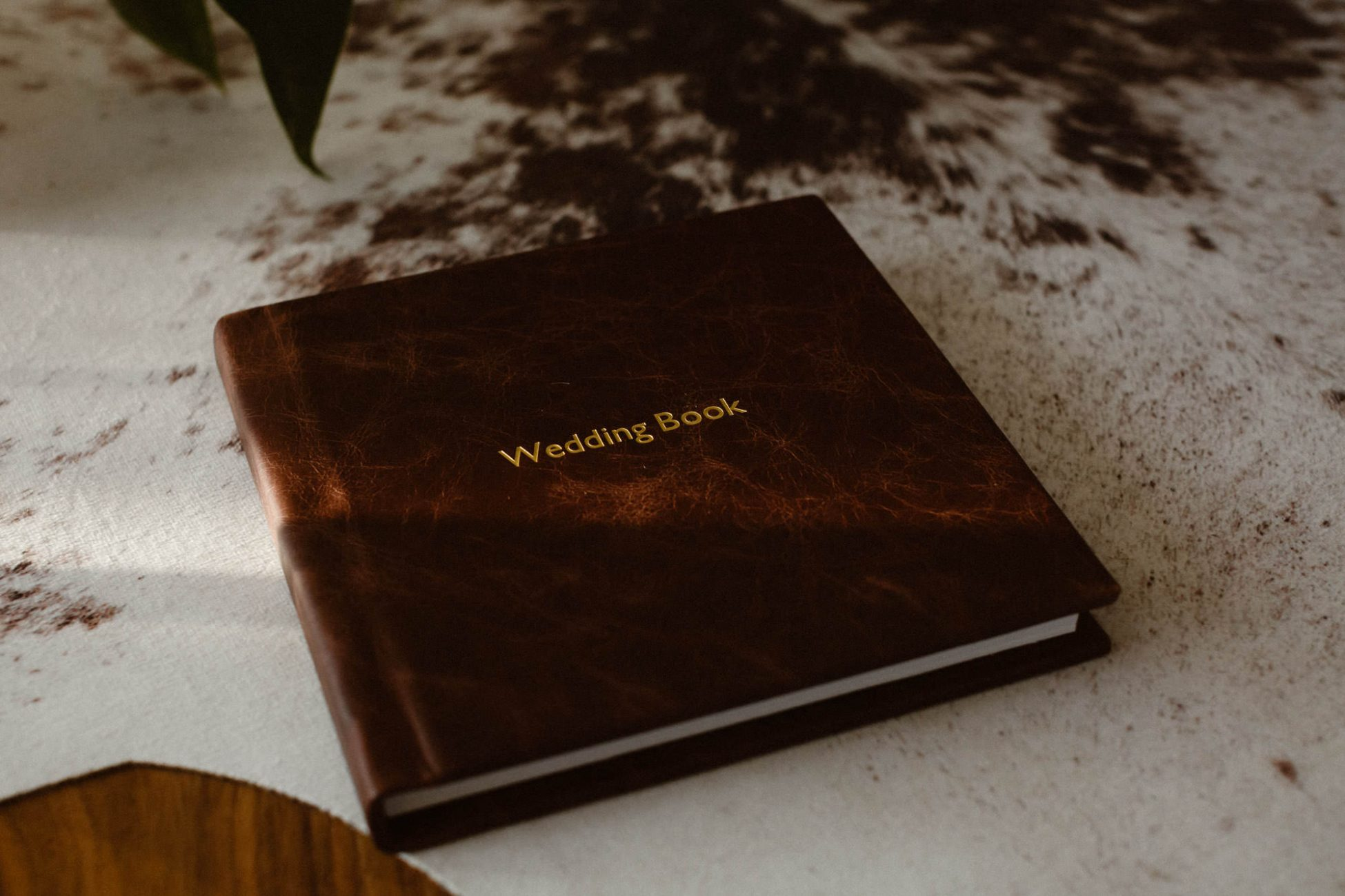 Bespoke leather and linen wedding albums